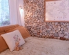 Casa Camilla Aspen Tropical Apartment bedroom stone wall