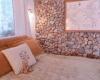 Casa Camilla Aspen Tropical Apartment bedroom stone wall